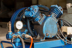 Piston Air compressor used in the factory. Air compressor Royalty Free Stock Photos