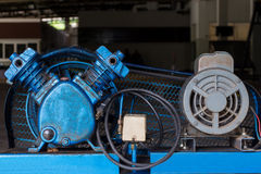 Piston Air compressor used in the factory. Air compressor Stock Photo