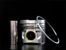 Piston, bolt and piston ring. On black background Royalty Free Stock Photos