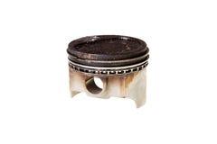 Piston deposits. Image of a used engine piston isolated on white background Royalty Free Stock Images