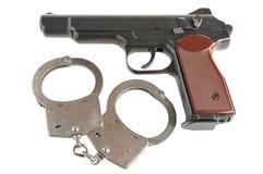 Pistool met geïsoleerd handcuffs Royalty-vrije Stock Foto