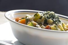 Pistou Soup. Soupe au pistou, French vegetable soup with pesto and basil Stock Photos