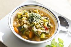 Pistou Soup. Soupe au pistou, French vegetable soup with pesto and basil Stock Photo