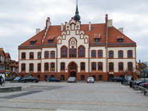 Pisz, the Town Hall. PISZ, POLAND - APRIL 11, 2014: Town hall in Pisz, built in 1900 , freshly renovated in 2013. Neogothic style Stock Images