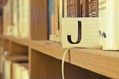 Pisze list J Zdjęcie Stock