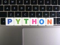 Pitão da palavra no fundo do teclado Fotografia de Stock Royalty Free