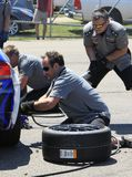 Pit crew tire change Royalty Free Stock Photography