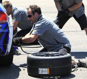 Pit crew  tire change Royalty Free Stock Photo