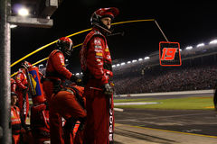 Pit Crew On the Wall Stock Photo