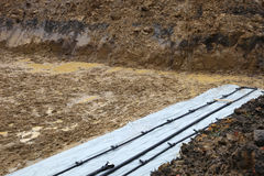 Pit with geothermal heat pipes. Stock Photos
