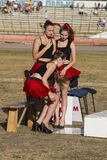 Pit lane girls getting ready for a competition. Rivne, Ukraine - 29 August 2015: Pit lane girls getting ready for a competition on the Open Cup Speedway to the Stock Photography