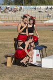 Pit lane girls getting ready for a competition. Rivne, Ukraine - 29 August 2015: Pit lane girls getting ready for a competition on the Open Cup Speedway to the Stock Photos