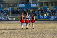 Pit lane girls getting ready for a competition. Rivne, Ukraine - 29 August 2015: Pit lane girls getting ready for a competition on the Open Cup Speedway to the Stock Photo