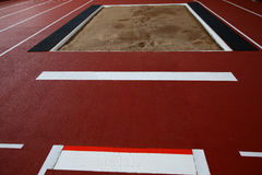 The pit for long jump. The indoor pit for long jump Stock Photo