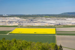 Pit Mine And Rape Field View Stock Images