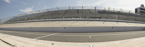 Pit row and backstretch at Motor Speedway. With empty stands stock image