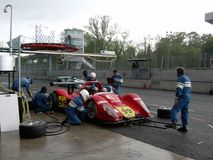 Pit Stop. During the Monza 1000km race of 2004 the Pilbeam MP91 of the PIR Competition (driven by Pierre Bruneau) is having his last pit stop to wear rain tyres Royalty Free Stock Images