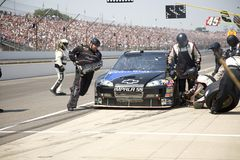 Pit Stop. The jackman for the Dale Earnhardt Incorporated team carries the jack to the other side of the card during a pit stop at the 2008 Allstate 400 at the royalty free stock photography