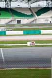 Pit stop, spectator grandstand and meshed fence. At a racing circuit stock photo