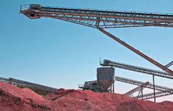 Pit surface mine. Conveyors and bulk tanks at an industrial Plant for mining of basic materials Royalty Free Stock Image