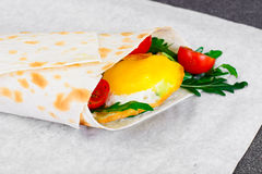 Pita Bread with Arugula and Fried Egg Royalty Free Stock Image