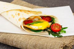 Pita Bread with Arugula and Fried Egg Stock Images