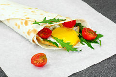 Pita Bread with Arugula and Fried Egg Royalty Free Stock Photography