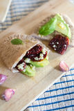 Pita bread with avocado and sundried tomatoes Royalty Free Stock Images