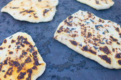 Pita bread baking on a Saj or Tava Royalty Free Stock Image
