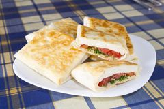 Pita bread with cheese, tomato and herbs Stock Photo
