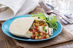 Pita bread with couscous and chickpeas Stock Photo
