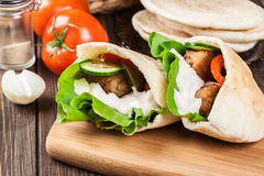 Pita bread with falafel and fresh vegetables Stock Photo