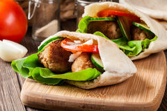 Pita bread with falafel and fresh vegetables Royalty Free Stock Photo