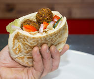Pita bread filled with falafel Stock Photo