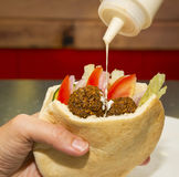 Pita bread filled with falafel Royalty Free Stock Photo