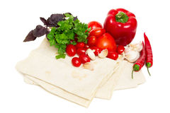 Pita bread and fresh vegetables Stock Photography