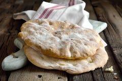 Pita bread. Freshly baked pita bread loafs on a rustic desk stock image