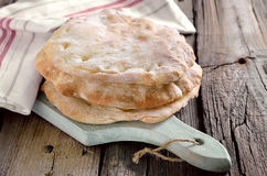 Pita bread. Freshly baked pita bread loafs on a rustic desk stock images