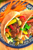 Pita bread with fried pork chop and vegetable, olive, spring pic royalty free stock photo