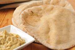 Pita bread with garlic hummus Stock Photos