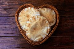 Pita bread isolated on white background in the breakfast basket, on rustic wooden table.Traditional food of Arabic cuisine. Pita bread isolated on white royalty free stock photo