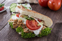 Pita bread with Kebab on wood Stock Photo