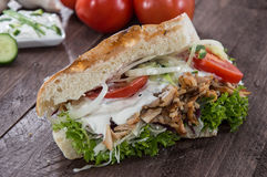 Pita bread with Kebab on wood Royalty Free Stock Images