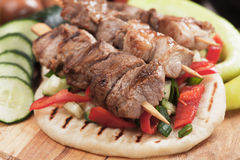 Pita bread and meat skewer Stock Photos