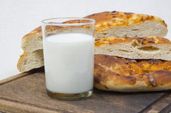 Pita bread with milk. close-up. Close-up. still life. glass of milk with baked pita bread and cheese on a tray Stock Photography