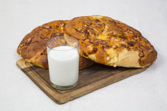 Pita bread with milk. Still life. glass of milk with baked pita bread and cheese on a tray royalty free stock photos