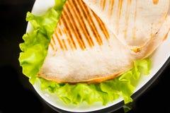 Pita bread pizza on fresh lettuce Stock Photos