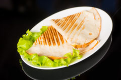 Pita bread pizza on fresh lettuce Royalty Free Stock Image