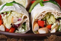 Pita bread roll with chicken and vegetables macro, horizontal Royalty Free Stock Photos