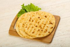 Pita bread. With salad over wood background stock photo
